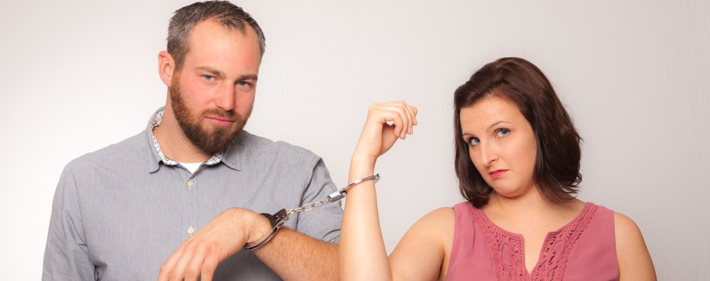 Man and woman handcuffed together